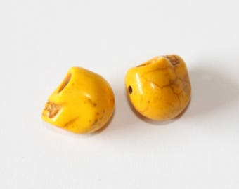 Death's head, yellow, 12 mm, the pair