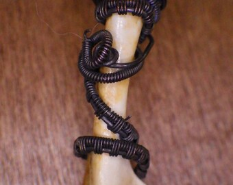 Bone pendant with patinated copper wire