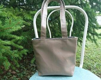 light brown leatherette handbag