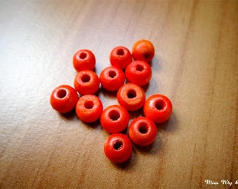 10 orange painted wooden beads