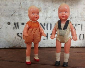 Two Hard Plastic Dollhouse Dolls