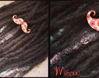 "Pearls dreadlocks or plaits ""pretty mustache"""