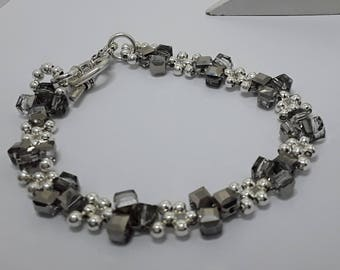 Bracelet weaved with swarovski beads and silver squares