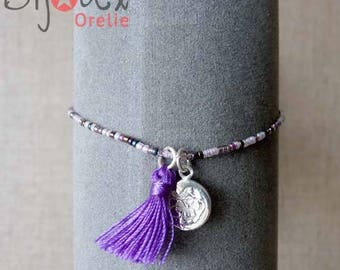 Bracelet with pearls and purple tassel