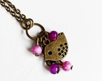 Necklace bronze, pink and purple beads, bird charm