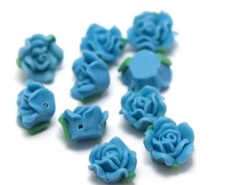"6 ""Polynesian flower"" No. 9, 15 x 9 mm blue beads"