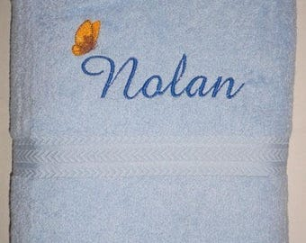 Towel embroidered with a name and a butterfly