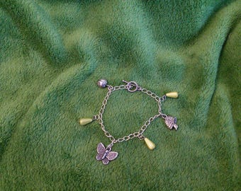 Yellow garden and drops charms bracelet
