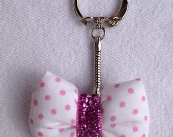 Pink door key with bow pads in white fabric with polka dots