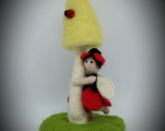 Poppy the needle felted flower fairy.