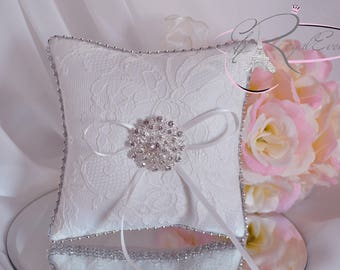 White cushion with romantic lace