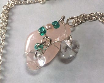 Rose quartz pendant with silver plated cage and chain, Swarovski clear crystal hearts and turquoise glass beads