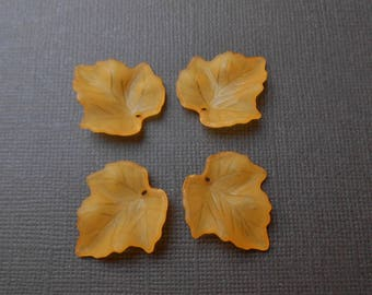 Set of 4 beads, charms or pendants leaf orange