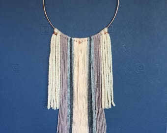 Soft pink copper hoop wall hanging