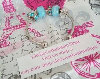 Blue charm bracelet