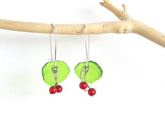 Silver earrings and small cherry