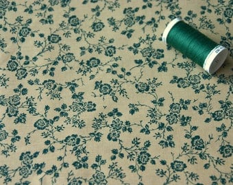 Patchwork fabric with green flowers on beige background