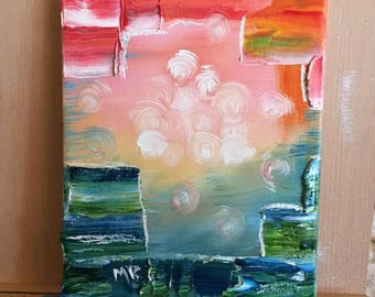 Abstract oil painting of the ocean and clouds at sunset