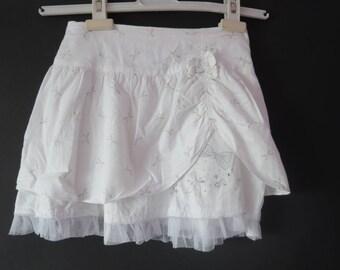 1999: 8 Orchesrtra ebondy white skirt