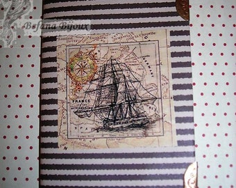 Ship notebook and postcard