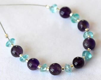 Beautiful lot of 15 beads composed of 7 round amethyst and apatite 8 rings