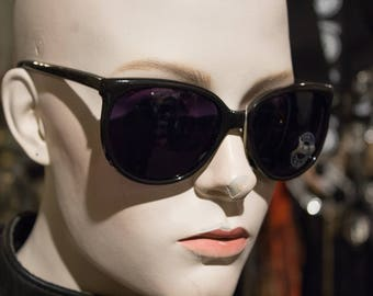 vintage 1980s plastic sunglasses with purple lenses in deadstock condition with tags