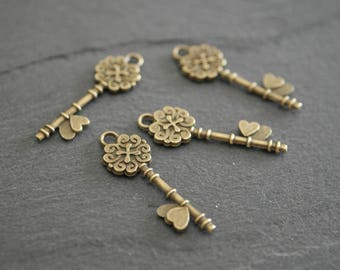 1 key, antique bronze charm, pendant 34 x 31mm