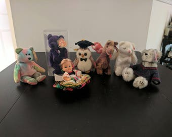 A collection of TY Beanie Babies, and an extra doll.