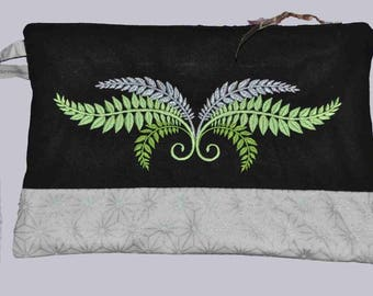 Black cotton pouch embroidered foliage.