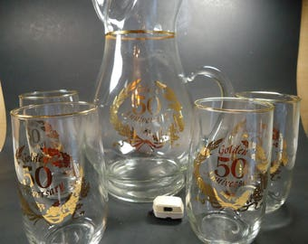 50 th Golden anniversary pitcher and 4 glsses