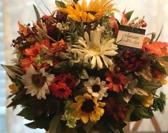 Medium size sunflower arrangement in a Pumpkin