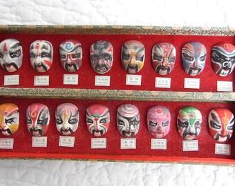 Set of 16 ceramic Chinese opera masks, hand painted.