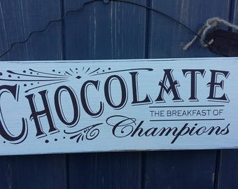 Chocolate, the breakfast of champions wooden sign.