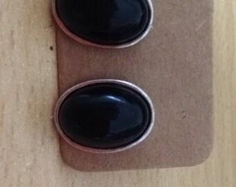 Oval black studs