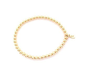 4mm beaded bracelet in gold