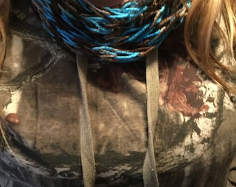 this is a blue and brown finger knitted infinity scarf