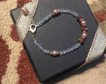 Pearl, clear and rose gold beads