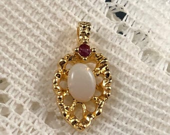 Gold tone opal and ruby necklace pendant