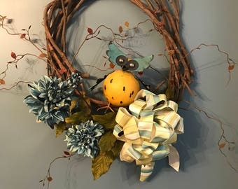 Vine wreath with silk flowers and owl