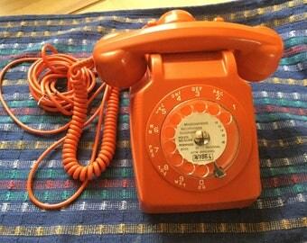 Orange vintage rotary phone