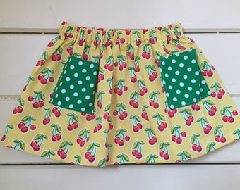 Little Girl's Yellow and Cherry Print Skirt With Green Polka Dot Pockets - Size 2T, 3T, 4T, and 5T