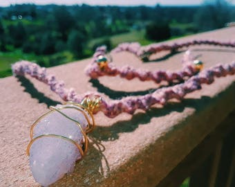 A long necklace and gold beaded braclette set.