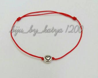 Red string with heart