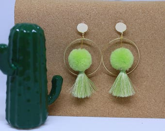 Green tassel pom pom with golden circle