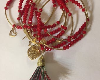 7 Red bead bracelets with gold plated accessories