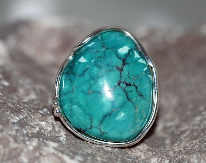 Featured listing image: Turquoise Ring. Impressive piece of Turquoise fitted in sterling silver. Handmade & unique. Ring is adjustable.