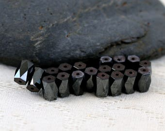 Hemetite faceted beads - set of 19