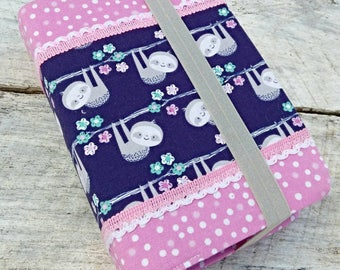 NWT Cute prints reversible fabric Bible cover, Sloths and polka dots, standard sized. Pink polka dot on reverse. Navy blue and pink.