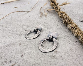east to here earrings
