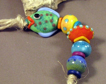 Handmade Lampwork Bead Set by Monaslampwork - Enameled Fish and Others - Multiple dots and enamels, full of color Handmade by Mona Sullivan
